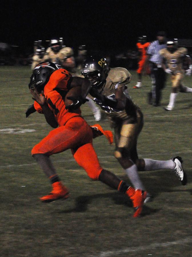 Quarterback NewK Tillman scrambles away from a Bears defender in Friday's victory.