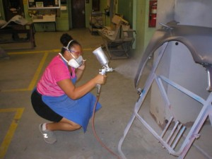 Pictured above Aviance Harris is spraying base coat to her fender panel.