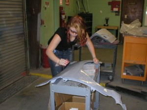 Shown above Katarina Harvey is wet sanding her panel to prepare for top coat application.