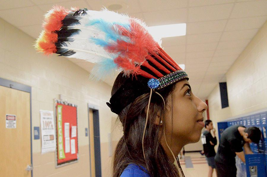Students wearing Native American headdresses presents the controversy of cultural appropriation.