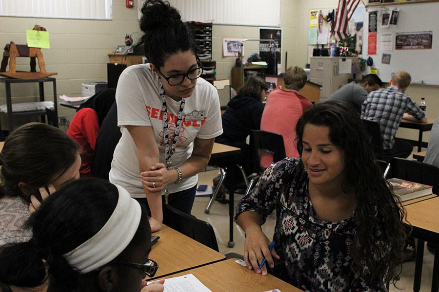 Teacher assistants at Seminole High help teachers while gaining experience in an educational environment.