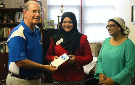 UNITED MUSLIM FOUNDATION SIGNS THOUSAND DOLLAR CHECK TO SEMINOLE