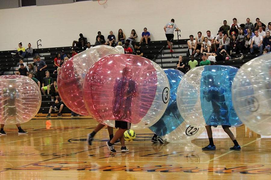 Students+competed+in+the+Bubble+Soccer+Tournament+to+fundraise+Senior+Week+and+the+senior+gift.+