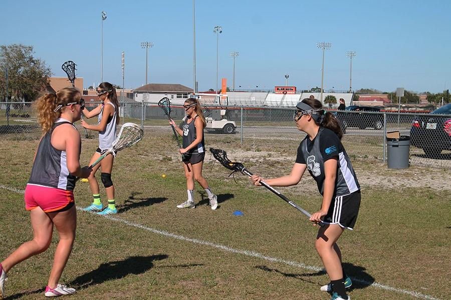 Lacrosse players practice for the new season.