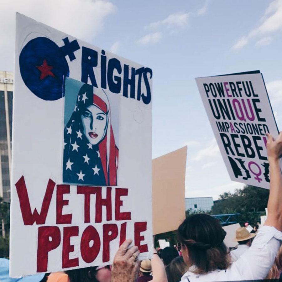 Student are taking an active role in politics like the Women's March in Orlando last month.