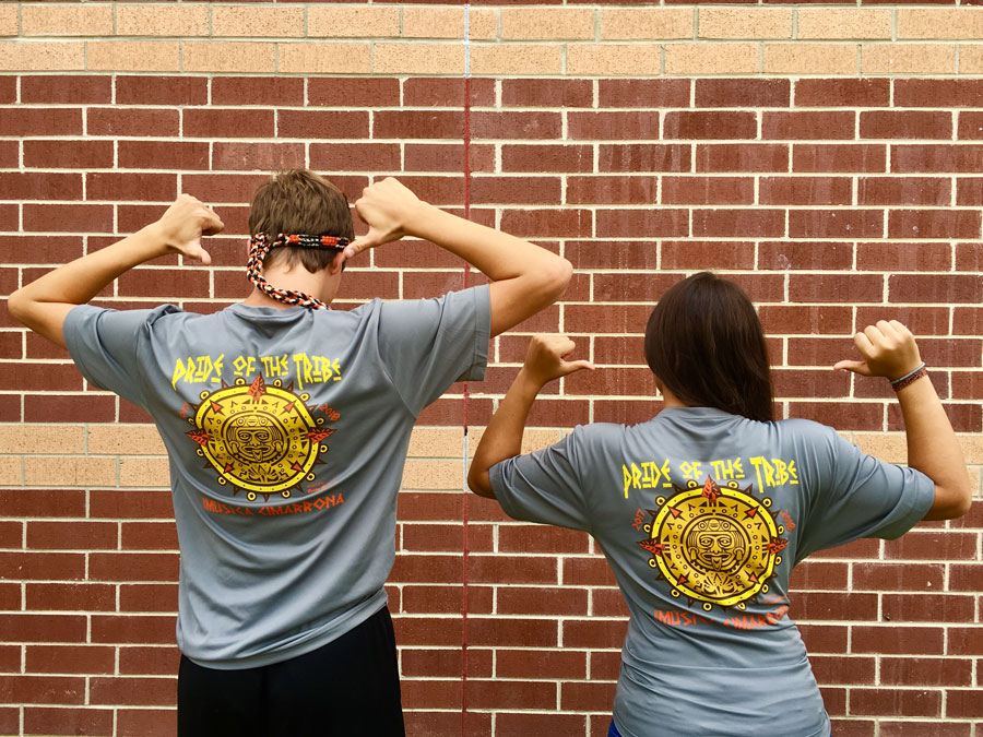 Band+students+are+proud+to+represent+The+Pride+of+the+Tribe+with+their+new+shirts.