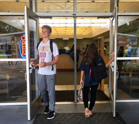 Freshman take their first steps into high school as seniors walk out.