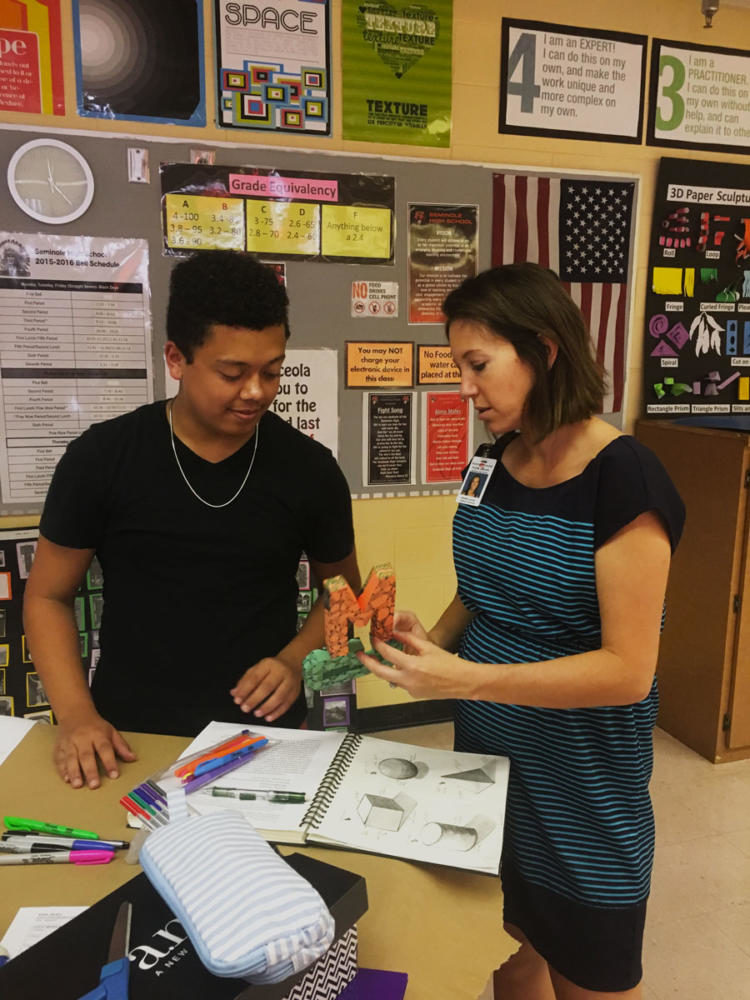 Mrs. Howard combines her passions of teaching and art by helping students in her 3D art class.