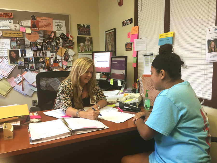 Kay Williamson, the 10th-12th grade guidance counselor, advises students according to their needs.