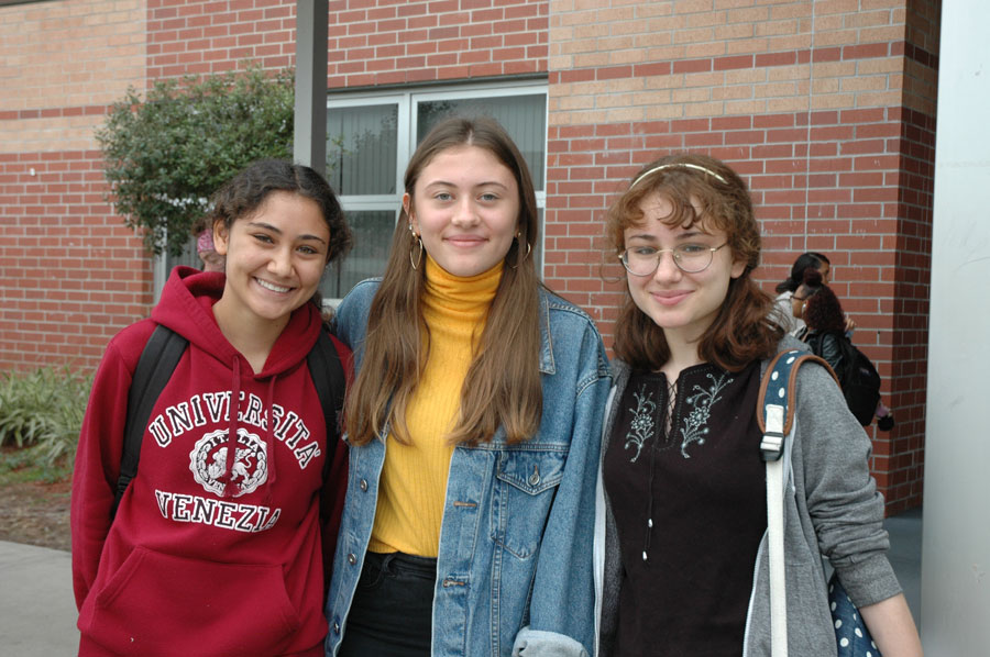 Sophomore Pia Vollmann (center) is an exchange student from Germany determined to live her best American life along with her host sisters, Aya (left) and Rowan Hassan (right).