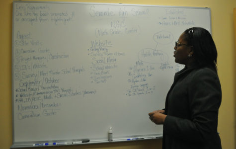 Ms. Jaime Washington, the 9th Grade Center director, reviews her plans for the coming months.