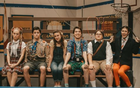 The main characters of the 25th Annual Putnam County Spelling Bee line up on the stage.
