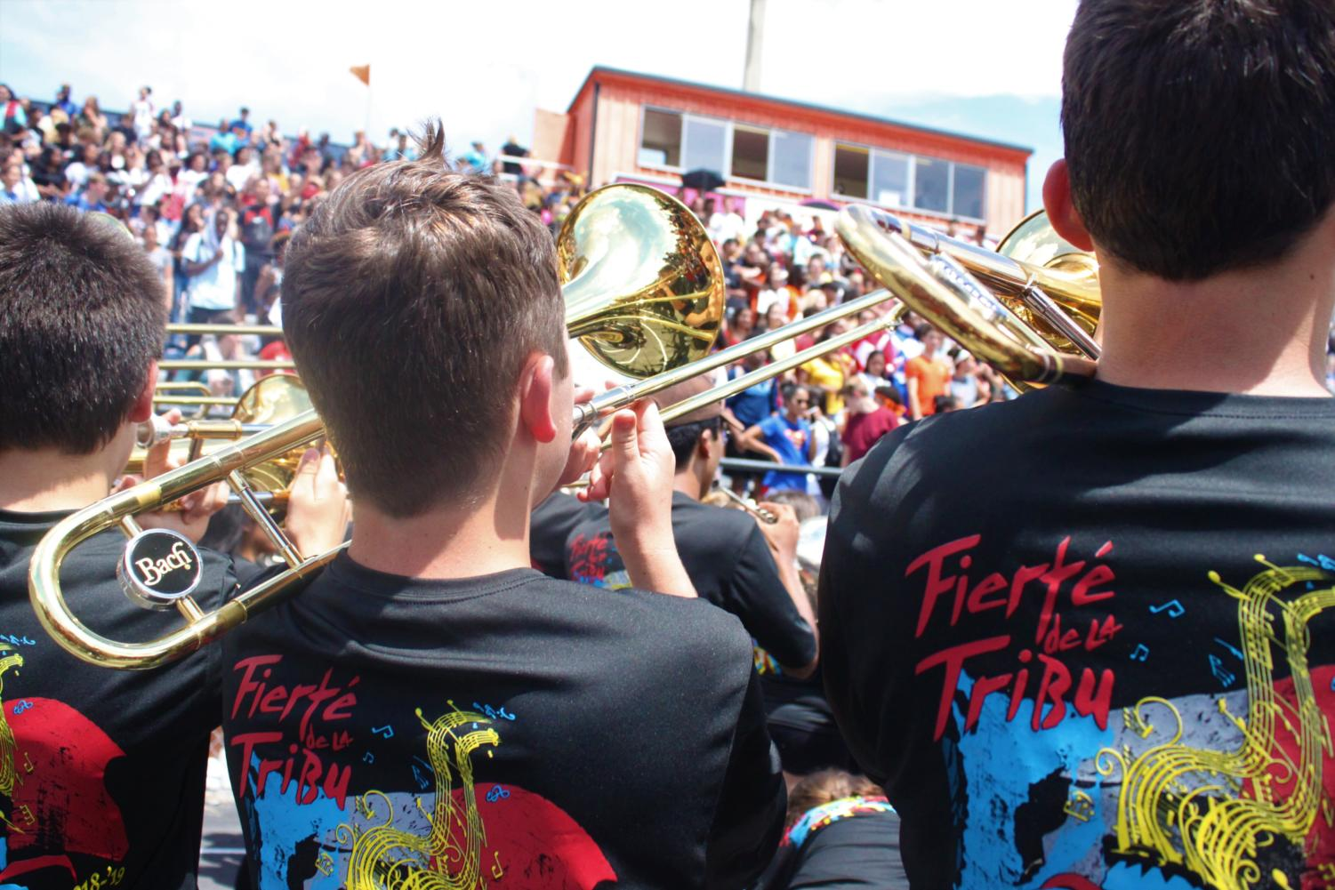 The France-bound band members proclaim their school spirit with vibrant new T-shirts.