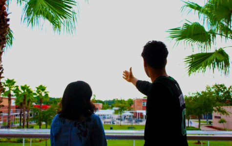 A senior talks with a freshmen and shows her the great views of Seminole High School.