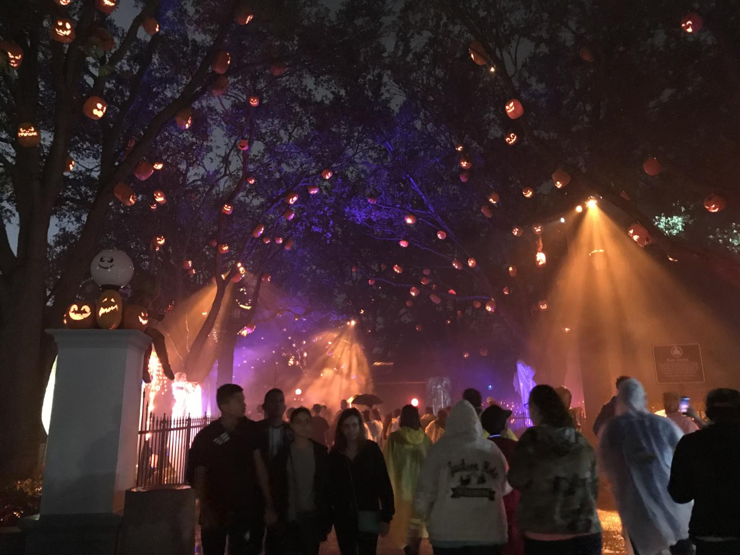 Visitors at Halloween Horror Nights in Orlando walk through one of their many scare zones.