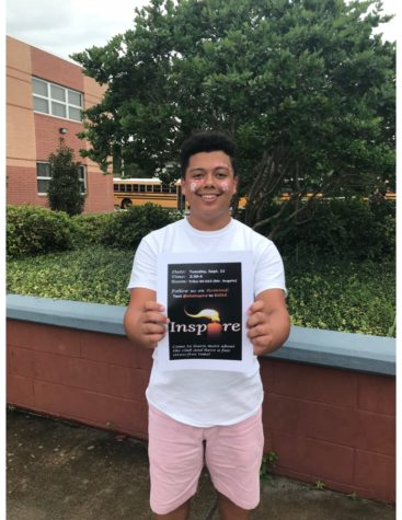 Senior Miguel Garzon holds up a flyer for his school positivity club, Inspire.