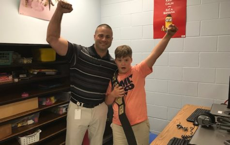 Dr. Rodriguez works with students in his final days at Rock Lake Middle School.