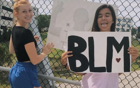 The year 2020 has involved some life changing events, an important one being the Black Lives Matter Movement. In this picture you see seniors Payton Whitney and Maddie Cannon with posters they made as they hang them over the city of Lake Mary. They did this to show their support and spread awareness to the movement as many other people are doing, whether through protests, donating, and or making signs like shown.